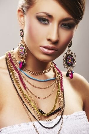 fashion woman with jewelry on light bacground Stock Photo - 5680376