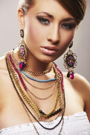 fashion woman with jewelry on light bacground