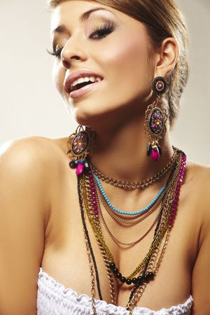 fashion woman with jewelry on light bacground photo