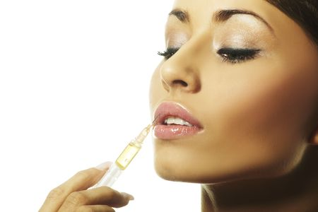 a nice girl with syringe making injection photo