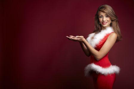 sexy fur: Sexy santa helper on red background
