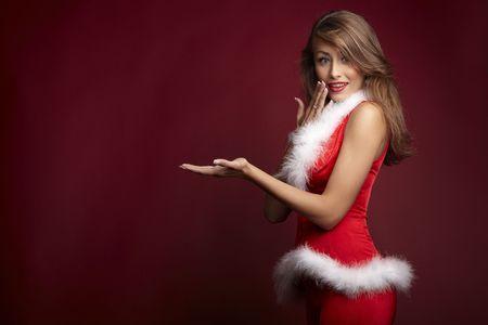 santas  helper: Sexy santa helper on red background