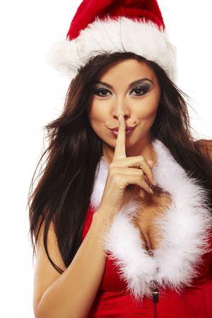 sexy christmas elf: Ritratto di una bella donna bruna indossando vestiti sexy di Babbo Natale
