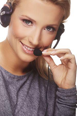 Close-up portrait of friendly secretarytelephone operator. Isolated on white background. photo