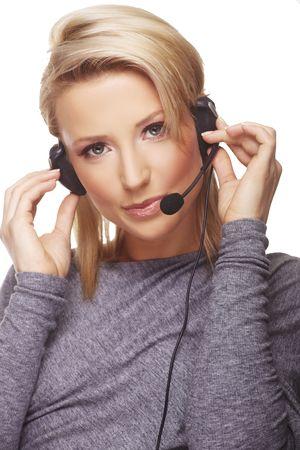 Close-up portrait of friendly secretary/telephone operator. Isolated on white background. Stock Photo - 5967930
