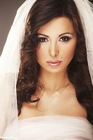 Face of beautiful young bride with happy smile photo