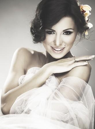 happy bride over gray background