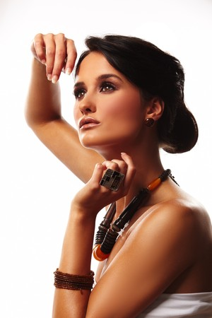 fashion woman with jewelry wood and stone on white background photo
