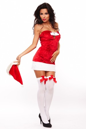 santa helper girl on white background with long hair and red hat photo