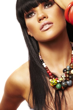 costume jewelry: one young beutiful brunette with long necklace