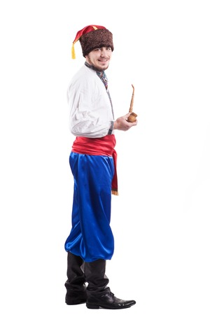 cossack: young cossack in national ukrainian dress isolated on white background Stock Photo