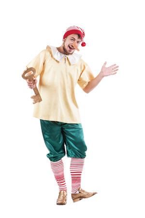 pinocchio: Young smiling man posing in Pinocchio costume or russian buratino Stock Photo