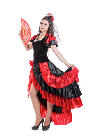 Traditional Spanish Flamenco woman dancer in a red dress with  fan Фото со стока