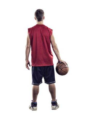 Basketball player standing back to camera with ball in hand isolated on white background