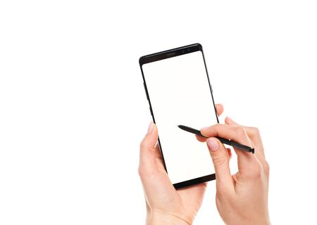 Woman hands working with stylus on black smartphone blank screen with modern frameless design isolated on white background Imagens