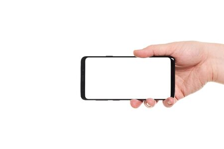 Man hand holding the black smartphone blank screen with modern frameless design isolated on white background