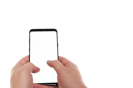 Man hand holding the smartphone blank screen with modern frameless design isolated on white background