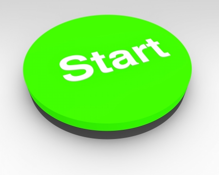 initiating: Green electronic Start button with a black base for initiating or starting a process on a piece of machinery or equipment Stock Photo