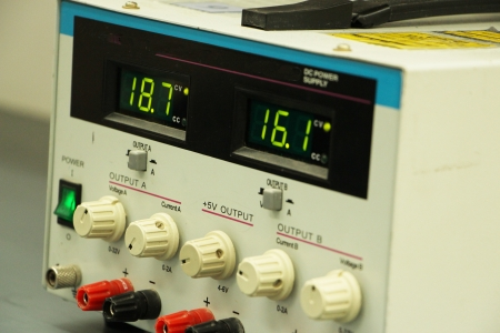 Closeup detail of a power supply with digital display readout showing two levels of output photo