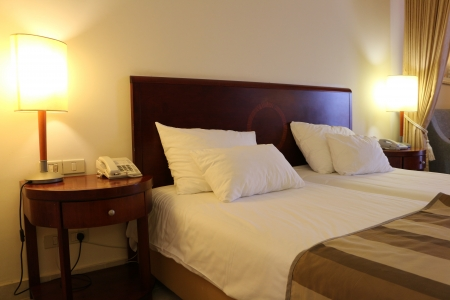 Hotel room equipped with queen size bed photo