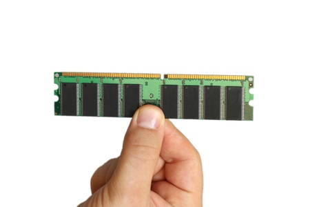 accessed: Man holding up a RAM module, or random access memory, in which all storage locations can be rapidly accessed in the same amount of time used by a computer operating system, on white