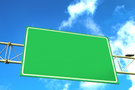 Blank green overhead traffic sign with copyspace for your text or destination against a cloudy sunny blue sky
