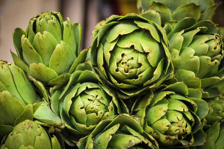 Green fresh organic artichokes in the market