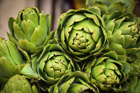 Green fresh organic artichokes in the market