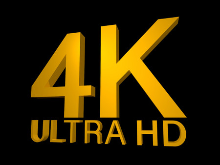 4K Ultra HD Logo in 3d golden lettering with a highlight to the K and an angled perspective on a black background 免版税图像
