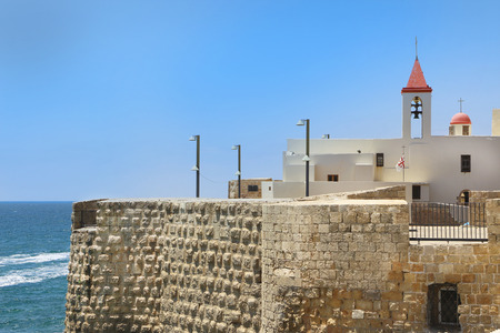 akko: Pizani harbor walls and St. John church in Acre, israel Stock Photo