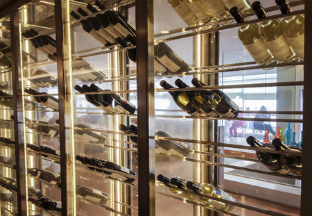 Elegant wine storage refrigerator with glass doors and metal wine shelves