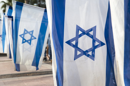 zionism: israeli flags held vertically during independence day ceremony