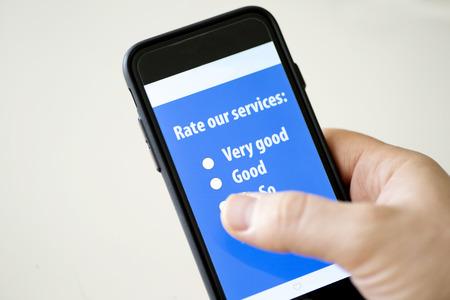 online survey: Online survey on a mobile phone Stock Photo