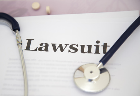 Medical Malpractice Paperwork Lawsuit Papers on desk of a doctor Archivio Fotografico