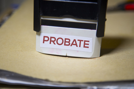 The word probate on a stamp on a big folder of paperwork Imagens - 50159290