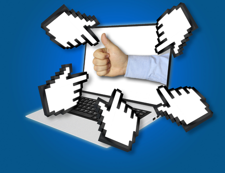 economic forecast: Online economic forecast concept with a businessman giving a thumbs up gesture of success and approval with pointing hand icons pointing at the laptop screen from all sides