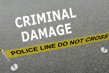 3D illustration of CRIMINAL DAMAGE title on the ground in a police arena. Police concept Stock Photo