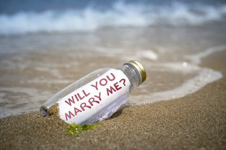 Marriage proposal in a bottle written on paper in a bottle washed ashore