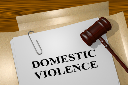 domestic violence: 3D illustration of DOMESTIC VIOLENCE title on legal document Stock Photo