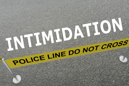 harass: 3D illustration of INTIMIDATION title on the ground in a police arena Stock Photo