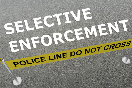 3D illustration of SELECTIVE ENFORCEMENT title on the ground in a police arena Stock Photo