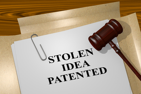 stop piracy: 3D illustration of STOLEN IDEA PATENTED title on legal document