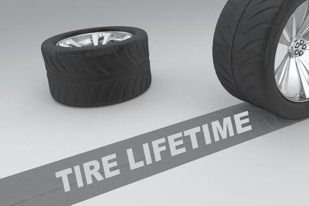 """3D illustratie van de titel """"TIRE LIFETIME"""" met twee banden als achtergrond Stockfoto"""