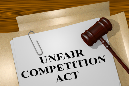 3D illustration of UNFAIR COMPETITION ACT title on legal document Stock Photo