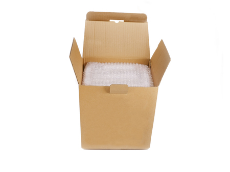 moving box: Empty carton box open and ready for closer and shipment with products protected in bubble wrap