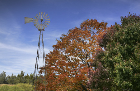 Typical NorthAmerican Countryside Landscape With Redish-Yellow Trees And Old Windmill