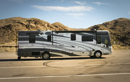 ARIZONA - OCTOBER 31, 2017: Self-propelled recreational vehicle parking in the desert.   RV offers living accommodation combined with a vehicle engine and is a common way to tour the US from coast to coast.