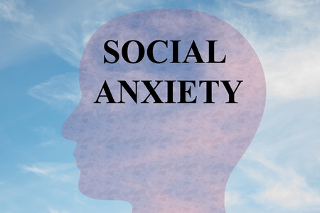 Render illustration of SOCIAL ANXIETY title on head silhouette, with cloudy sky as a background. Stock Photo