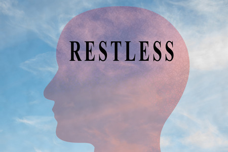Render illustration of RESTLESS title on head silhouette, with cloudy sky as a background. Stock Photo