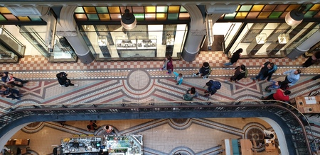 Top-view look inside Queen Victoria Building is a heritage-listed late-nineteenth-century building designed by the architect George McRae